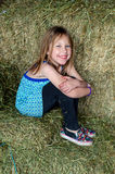 Smiling girl in hay bales Stock Photos