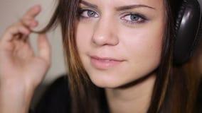 Smiling Girl in headphone stock footage