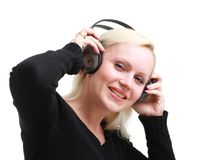 Smiling girl with headphones. Closeup against isolated white background Stock Photos