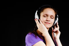 Smiling girl in the headphones Royalty Free Stock Photo