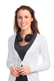Smiling girl with headphones. Posing against white background Royalty Free Stock Image