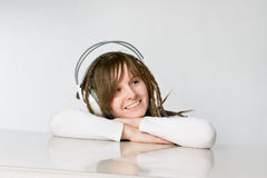 Smiling girl with headphones. Laying  on her elbows Stock Images
