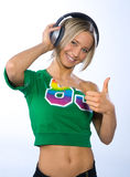 Smiling girl with headphones. Listen music Royalty Free Stock Photo