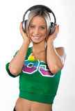 Smiling girl with headphones. Listen music Stock Photo