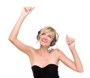 Smiling girl with headphones dancing. Against isolated white background Royalty Free Stock Photo
