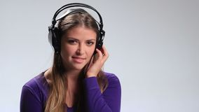 Smiling girl in headphones listening mp3 player stock video footage