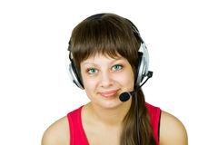 Smiling girl in headphones with microphone. Smiling girl in headphones with a microphone on the isolated white background Stock Photo