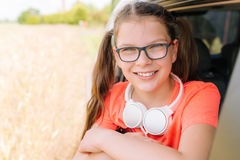 Smiling girl with headphones outdoor. Cute smiling girl with headphones outdoor Stock Images