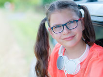 Smiling girl with headphones outdoor. Cute smiling girl with headphones outdoor Stock Photo