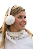 Smiling girl in headset ear muffs. Smiling beautiful girl in ear muffs Stock Photography