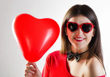 Smiling girl with heart glasses Stock Image