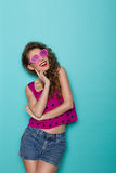 Smiling girl in heart shaped glasses lookin up