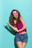 Smiling girl in heart shaped glasses Royalty Free Stock Image