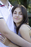 Smiling girl and her boyfriend embracing Royalty Free Stock Photos