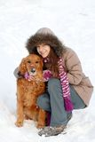 Smiling girl and her dog Stock Images