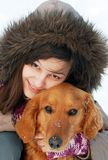 Smiling girl and her dog Stock Photos