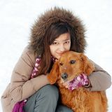Smiling girl and her dog Royalty Free Stock Image