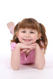 Smiling girl on her stomach Royalty Free Stock Photo