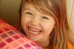 Smiling girl hiding royalty free stock photography