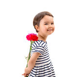 Smiling girl hiding a bouquet of red carnations Royalty Free Stock Image