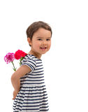 Smiling girl hiding a bouquet of red carnations isolated Royalty Free Stock Images
