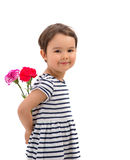 Smiling girl hiding a bouquet of red carnations isolated Stock Photo