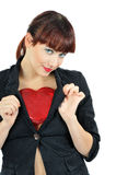 Smiling girl hiding heart under coat Stock Image