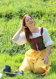 Smiling girl in historical dress Royalty Free Stock Photos