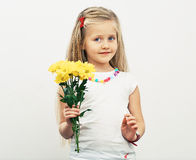 Smiling Girl hold yellow flowers. Royalty Free Stock Photo