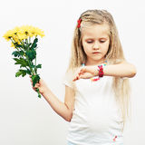 Smiling Girl hold yellow flowers. Royalty Free Stock Image