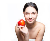 Smiling girl holding apple in hand Royalty Free Stock Photo