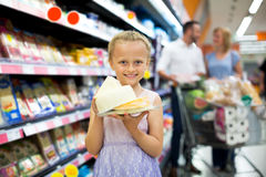 Smiling girl holding assortment of cheese Royalty Free Stock Photography