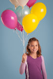 Smiling Girl Holding Balloons Stock Photography