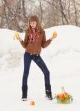 Smiling girl holding a banana and lemon Royalty Free Stock Images