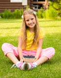 Smiling girl holding basket with berry Stock Photography