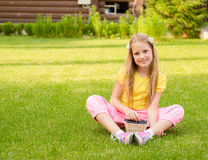 Smiling girl holding basket with berry Royalty Free Stock Photos