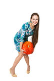 A smiling girl is holding a big red pumpkin Royalty Free Stock Photography