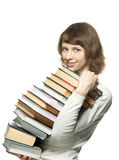 The smiling girl holding a big stack of books Royalty Free Stock Photos