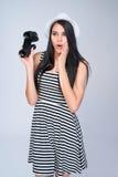 Smiling girl holding binoculars Royalty Free Stock Image