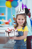 Smiling girl holding birthday cake Stock Photography