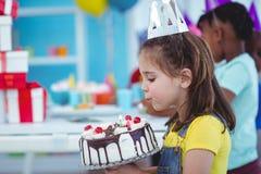 Smiling girl holding birthday cake Royalty Free Stock Photo