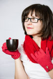Smiling girl holding a black cup Stock Photo