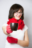 Smiling girl holding a black cup Stock Photography