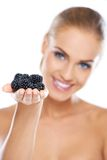 Smiling girl holding blackberries on hand Royalty Free Stock Images