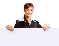 Smiling girl holding a blank billboard. Beautiful smiling girl holding a blank billboard stock photo
