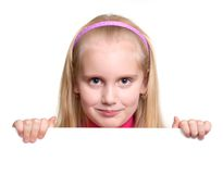 A smiling girl holding a blank white board Royalty Free Stock Photography