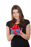 Smiling girl holding blue gift box with red ribbon Stock Photos