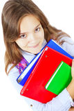 Smiling girl holding books isolated over white Stock Image