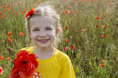 Smiling girl holding bouquet poppies stock photo