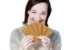 Smiling girl holding bread crisps Stock Photography
